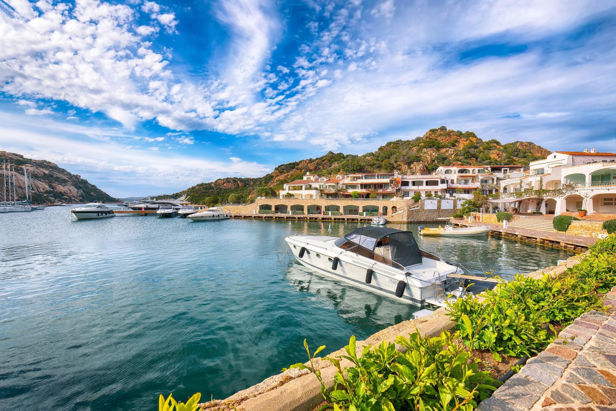 Astonishing view of Poltu Quatu port and bay with yachts and motorboats on Costa Smeralda. Popular travel destination of Mediterranean sea. Location: Poltu Quatu, Province of Sassari, Sardinia, Italy